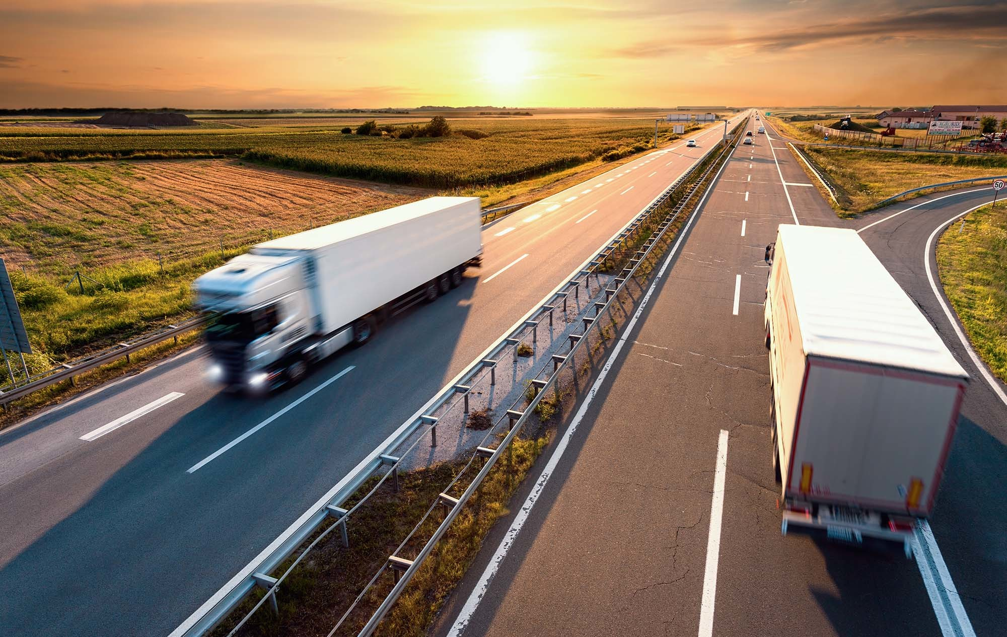 Two trucks on the highway powered by climate-friendly fuels
